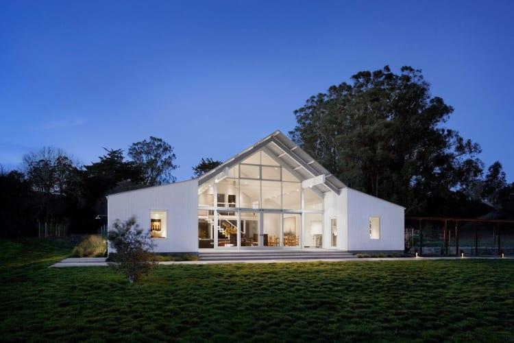 Dusk shot of barn-like home designed by architects Turnbull Griffin Haesloop