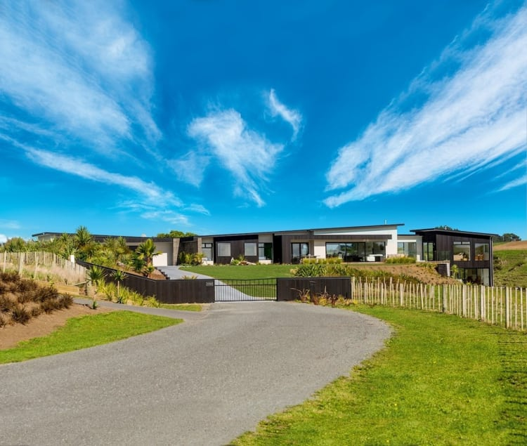 At home on the land – this luxurious Fowler Homes Taranaki residence plays down  its scale from the street approach.