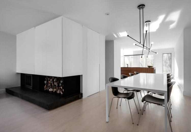 Dining and fireplace in Montreal renovated home by Appareil Architecture