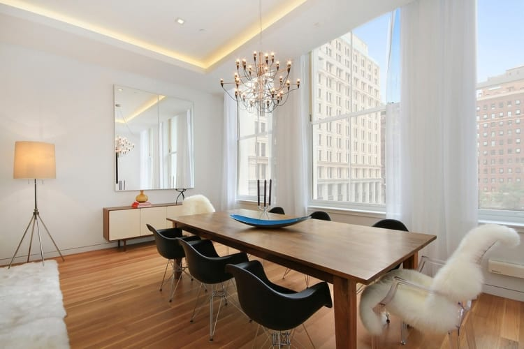 This apartment living area in 738 Broadway overlooks surrounding historic buildings