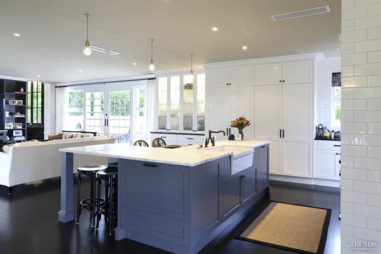 Traditional kitchen with Art Deco influence and hand-painted cabinets