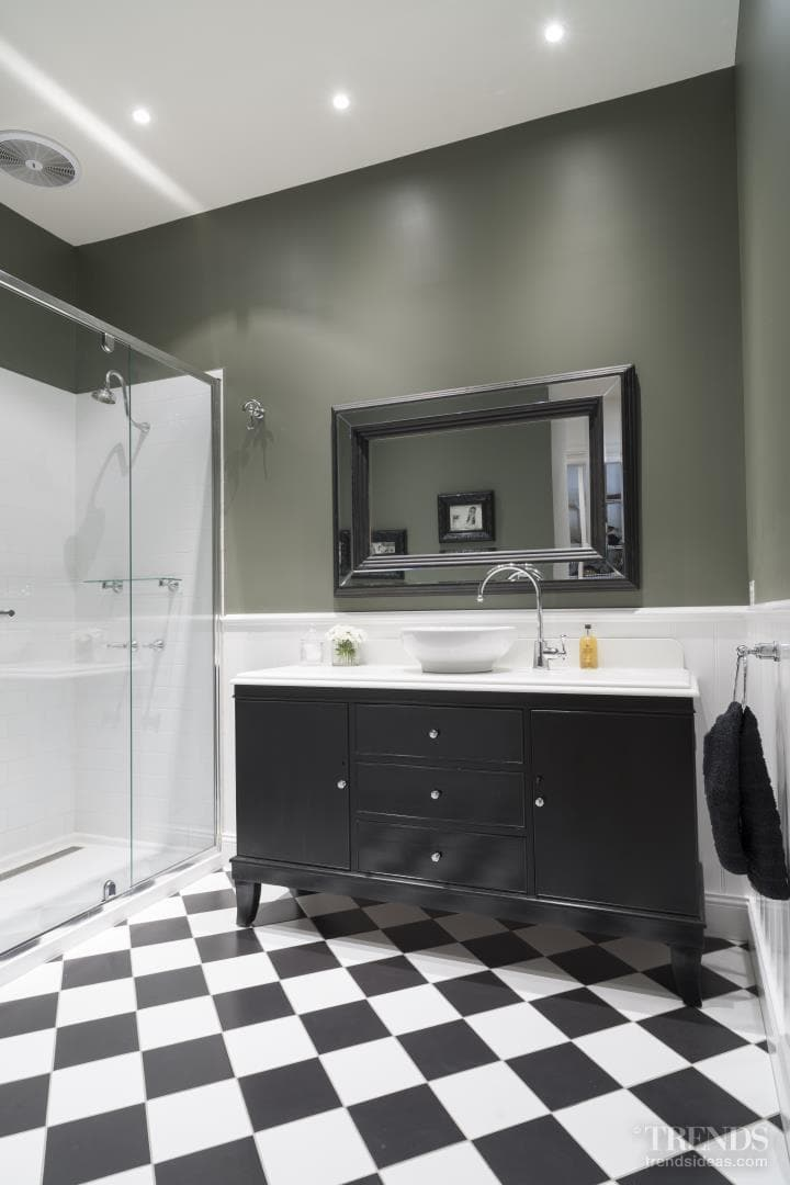 Black and white bathroom includes modern and traditional accents with touches of glamour