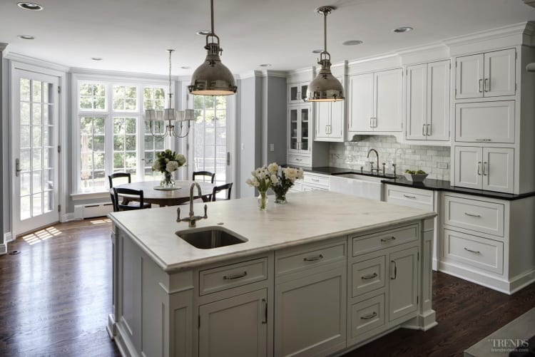 Kitchen With Granite And Marble Countertops And Subway Tile Splashback