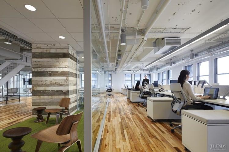 Contemporary loft-style office interior in Art Deco Chicago building for social media team