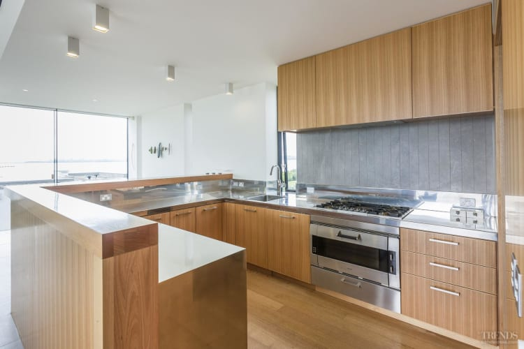 Sleek modern kitchen with tasmanian oak veneer and for Sleek modern kitchen cabinets