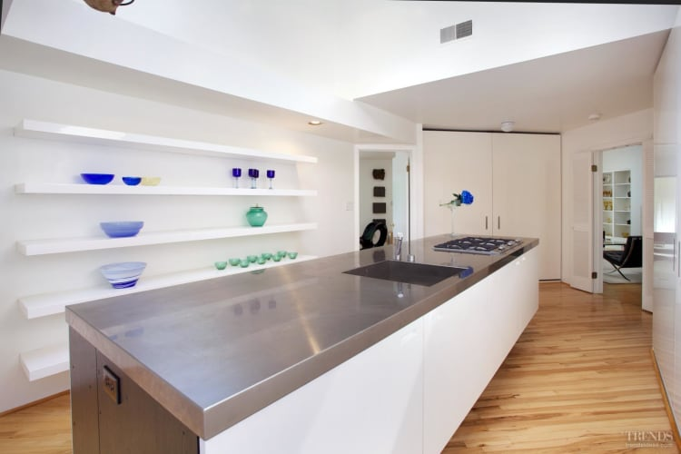 Floating Island In Minimalist White Kitchen With Concealed Appliances Open Shelving