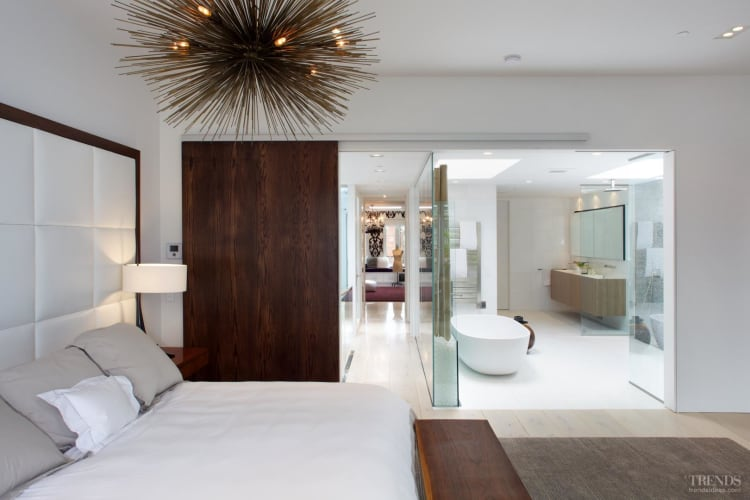 Resort-style bathroom with freestanding bath, large skylights, glass wall and bamboo screen