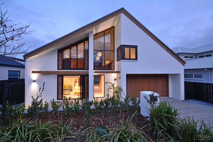 Contemporary beachside show home with bagged brick exterior, gabled roofline