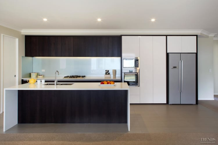 New kitchen with dark timber veneer and white gloss lacquer