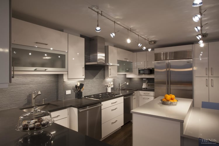 Remodeled apartment kitchens showing ways to optimize functionality and visual impact in a restricted space