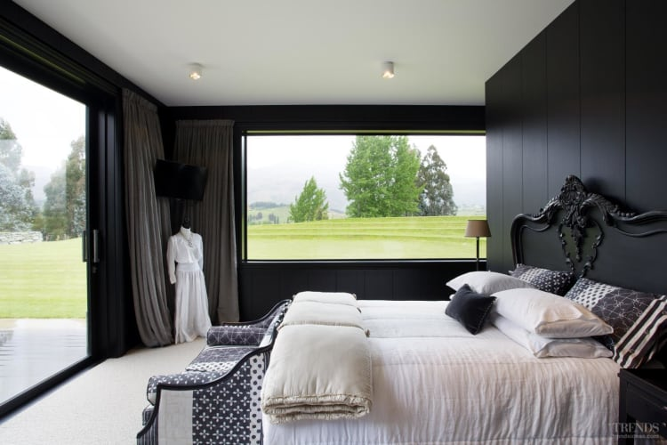 Black and white master suite and guest bathroom in contemporary country house