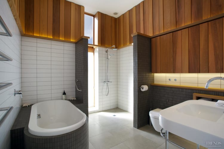 Bathroom renovation in older bungalow features shiplap cedar, grey mosaics and white tiles