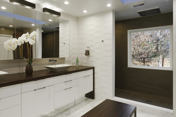 Modern White Bathroom With Textured Tiles Shower Zone And Central Bench With Storage