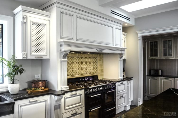 Formal cabinet door style toned down by rustic design elements