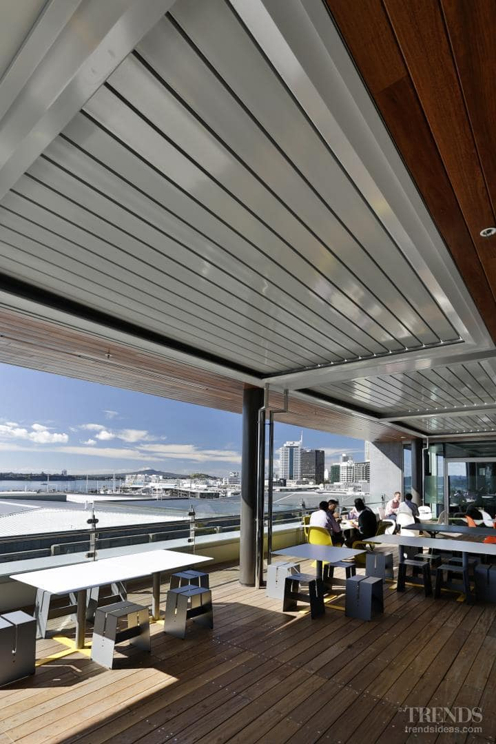 Operable louvre roofs make the most of entertainment deck for office staff