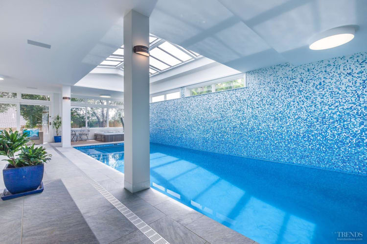 An architectural concrete inground pool is an asset to your home