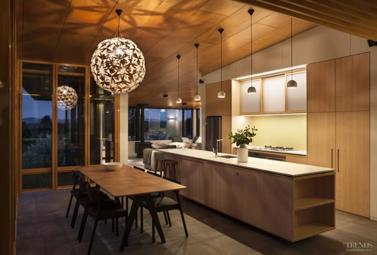 Bamboo kitchen cabinetry integrates with wider use of wood through this home's interior