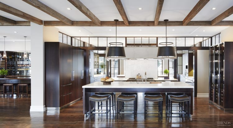 Two fully functional kitchens sit back-to-back in this expansive lakeside home