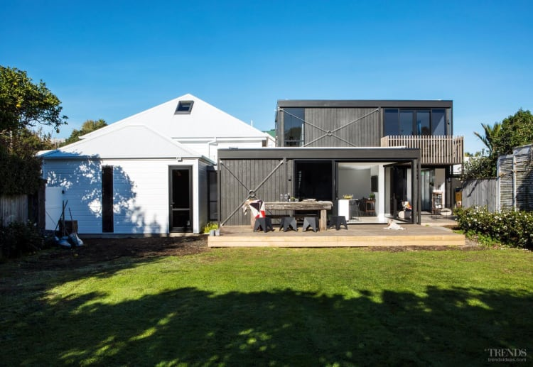 Classic cottage meets modern rear addition in this renovation project