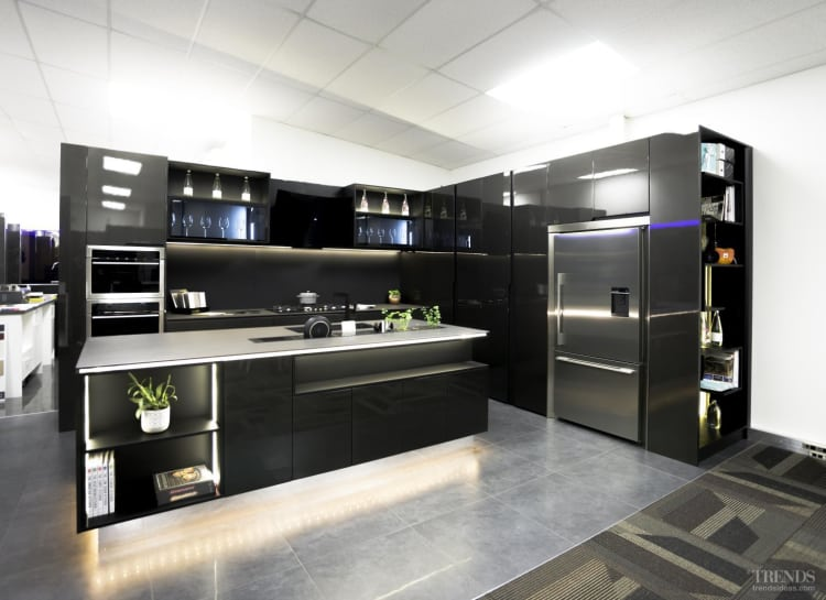 Feature lighting transforms this upmarket kitchen at night