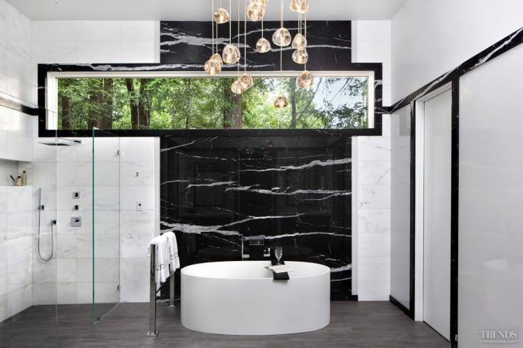 Two-tone stone surfaces tie this modern bathroom to its older, more classic home