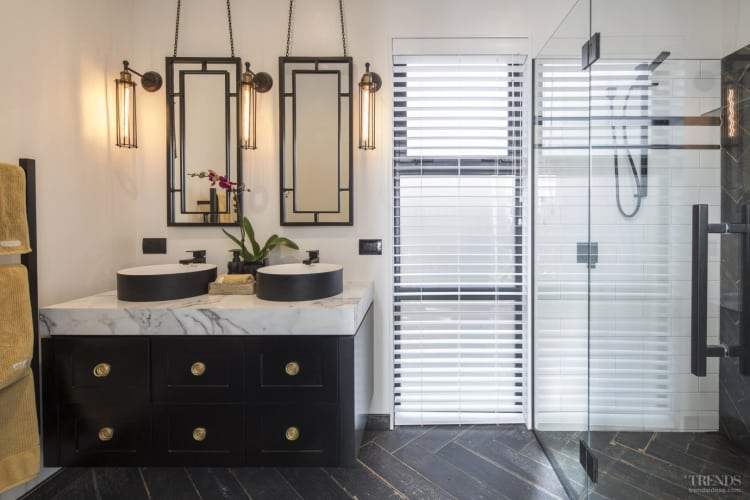 A new master bathroom suite gets an opulent touch by the simple use of black and gold