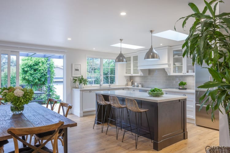 Renovated kitchen now connects to adjacent spaces and improves flow of home