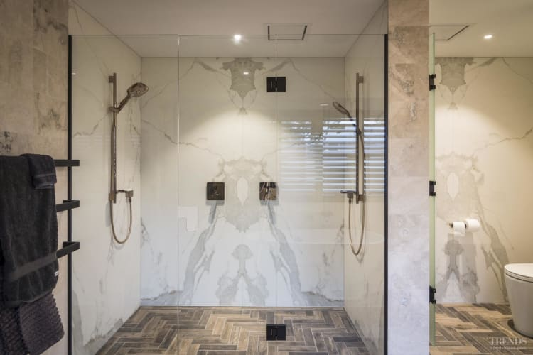 Mix of rich surfaces gives this bathroom the feel of a luxury retreat