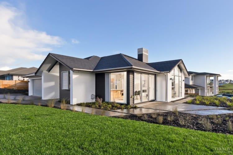 Millwater showhome has flowing living spaces and a sheltered al fresco dining area