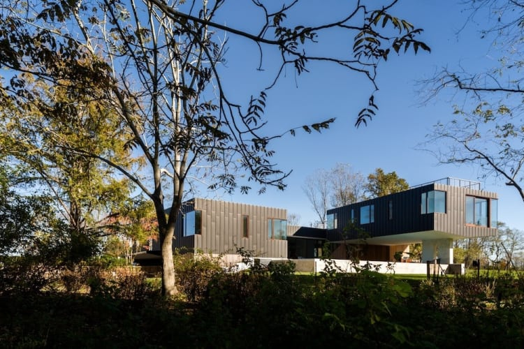 Given the unique floodplain location, the architects needed to suspend certain parts of the home above ground