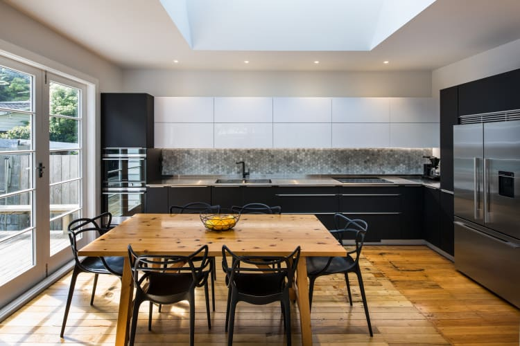A substantial skylight sits above the kitchen
