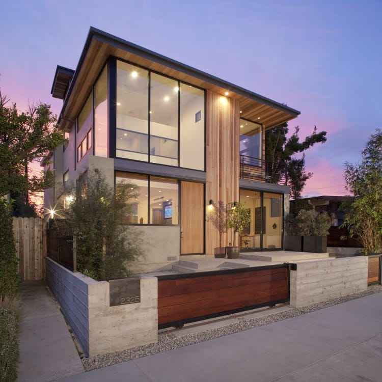 Outside, the home is inviting, with substantial windows