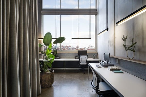 Large windows throughout this office mean no shortage of light for the staff inside