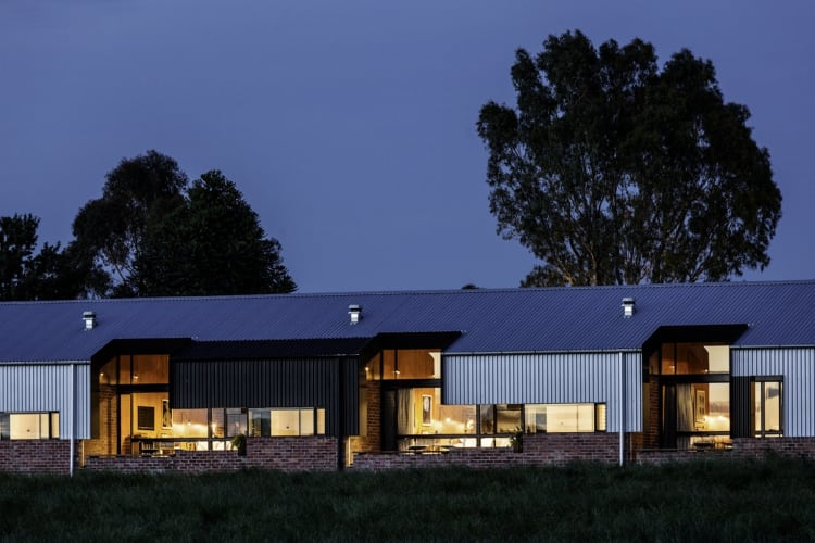 This night shot shows the expansive windows