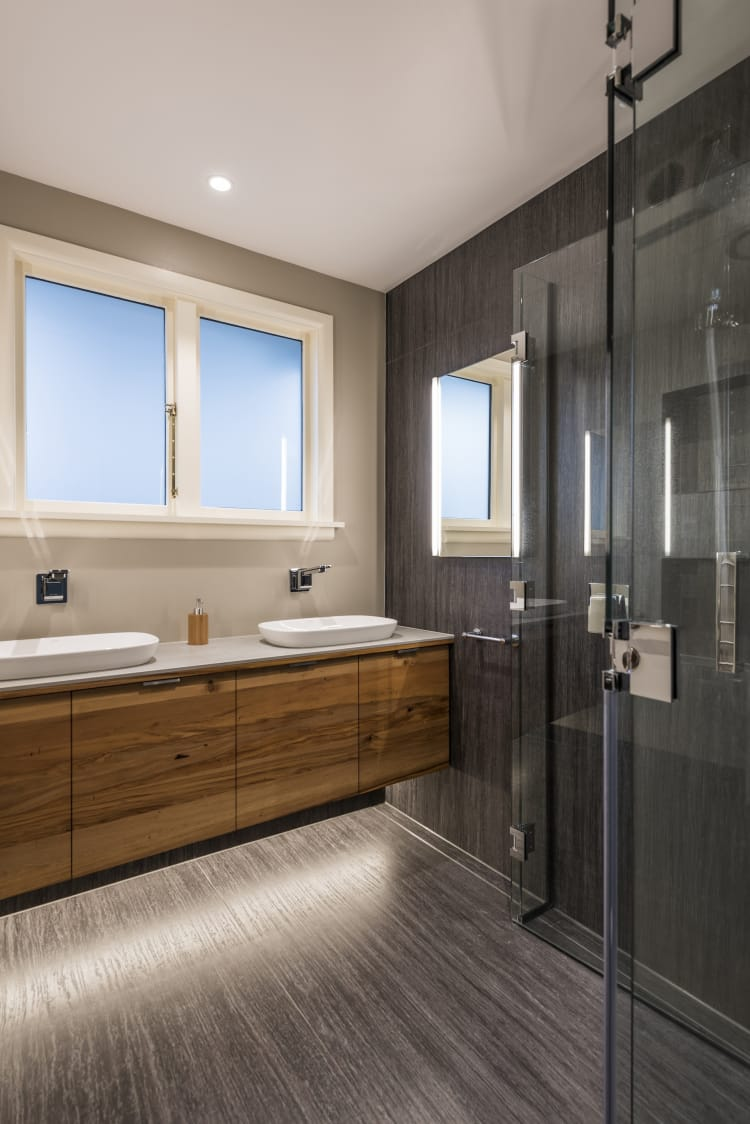 On this bathroom renovation  by Jason Higham, the doors of the shower fold back to the wall, maximising the available space in the room.