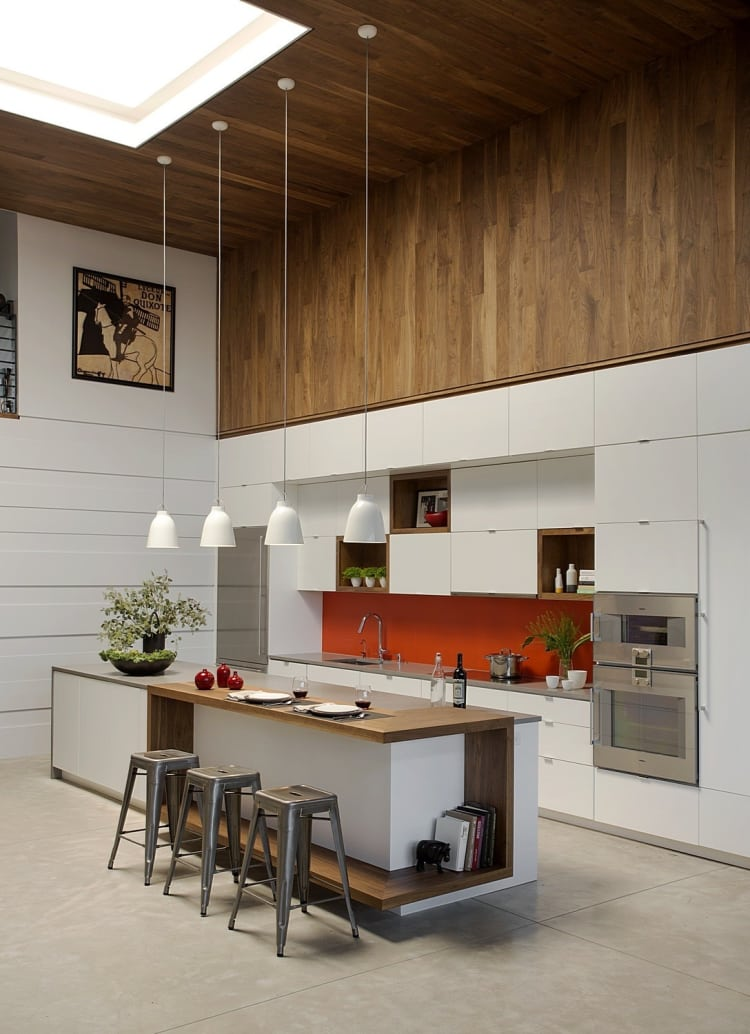 This kitchen features a seriously high ceiling and delightful wood and white elements. It's perfect for entertaining