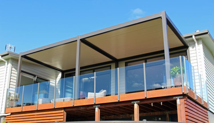 HomePlus Tauranga fitted three Bask louvre roofs for a customer to help them to extend their outdoor living year round.