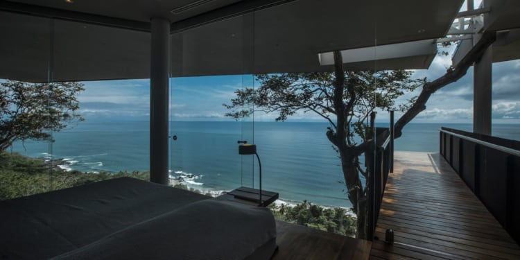 From the main bedroom you're able to see the ocean extending out below