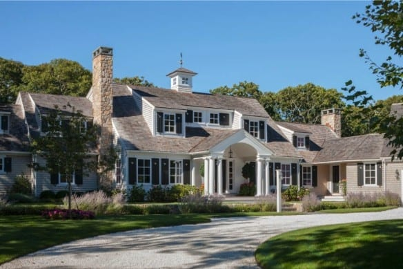 The architects completely redesigned the entry porch and roof with classic columns and a clean/classic gable roof design