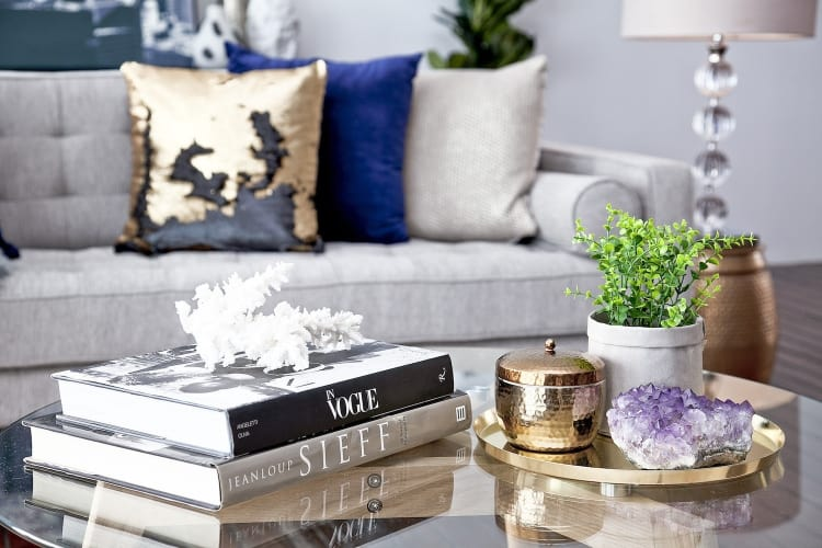 Look to small plants, coral, shells and crystals to glam up side tables and coffee tables