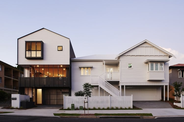 The existing Queenslander sits on the right, with the first of the new homes on the left