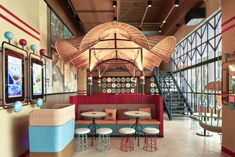 A gigantic Gyoza-shaped canopy woven with synthetic rattan sits above the main dining area