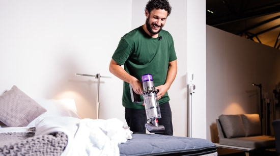 I challenge you to vacuum your mattress using arm, bed, bedroom, clothes iron, furniture, home appliance, joint, room, shoulder, textile, vacuum cleaner, white