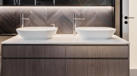 ​​​​​​​Oak-look vanity cabinet fronts complement the subtle tones architecture, bathroom design, sink, tap, gray, black, taps, vanity, Melonie Bayl-Smith,  Andrew Lee, Bijl Architecture