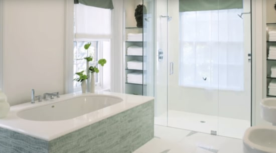 Bathroom renovation including wave shaped Sinuous mosaic tiles in pale green with white fixtures