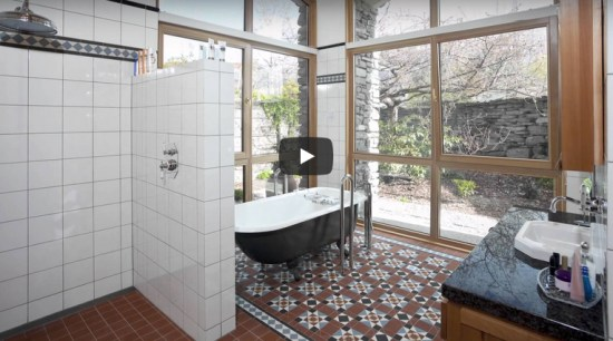 Large windowed bathroom using mosaic tiling to create a feature