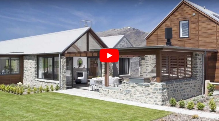 Central Otago style cottage open to the landscape featuring gabled pavilions and stone cladding