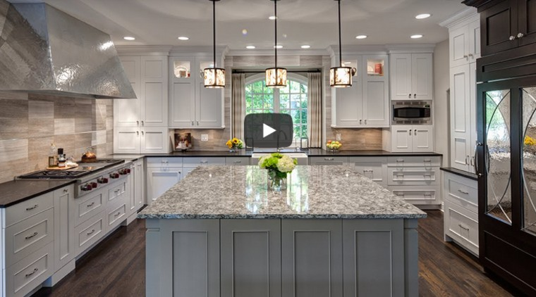Remodeled kitchen in white and dark-stained maple wood has subtle French influence.