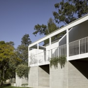 Intimate courtyards are created for the lower level