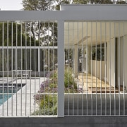The regulatory pool fence (typically an obstruction between